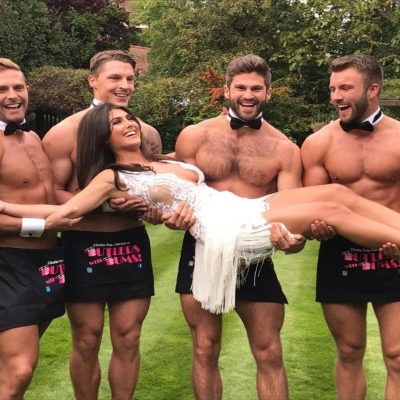 Four topless butlers holding a customer at private event in Ireland